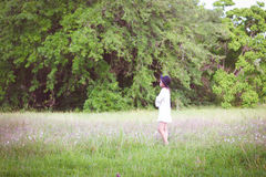 Girl Wearing Long Sleeve Shirt Standing on Green Grass Royalty Free Stock Photography