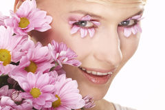 Girl wearing makeup made of flowers Royalty Free Stock Images