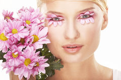 Girl wearing makeup made of flowers royalty free stock photo