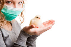 Girl wearing mask with chicken Royalty Free Stock Images