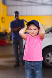Girl wearing mechanic's cap Stock Photo