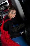 Girl wearing mechanic uniform Royalty Free Stock Images