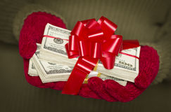 Girl Wearing Mittens Holding Stacks of Money with Red Ribbon Stock Images