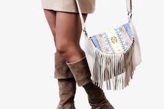 Girl wearing modern purse Stock Images