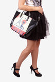 Girl wearing modern purse Royalty Free Stock Images