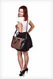 Girl wearing modern purse Royalty Free Stock Image
