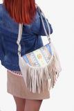 Girl wearing modern purse Stock Photography
