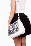 Girl wearing modern purse Royalty Free Stock Photography