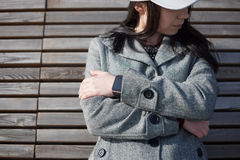 Girl wearing modern smart watch on her wrist Stock Images