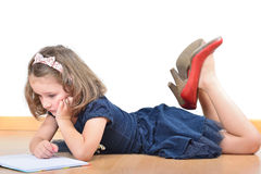 Girl wearing mother's shoes is reading and posing Stock Photos