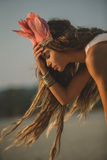 Girl wearing native indian headdress Stock Images