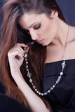 Girl wearing a necklace Stock Image