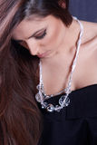 Girl wearing a necklace Royalty Free Stock Images