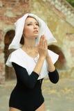 Girl wearing a nun clothes praying Royalty Free Stock Photos