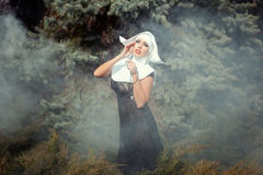 Girl wearing a nun. Royalty Free Stock Image