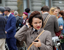 Girl wearing old fashioned tweed clothes fixing the hat Royalty Free Stock Photos