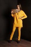 Girl wearing orange cardigan. studio portrait Royalty Free Stock Photo