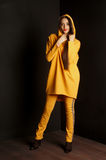 Girl wearing orange cardigan. studio portrait Royalty Free Stock Images