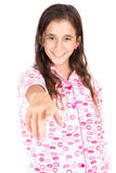 Girl wearing pajamas and pointing a finger at the camera Stock Photos