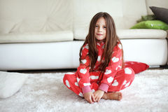 Girl wearing pajamas Royalty Free Stock Images