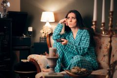 Girl Wearing Pajamas Watching TV in her Room. Funny woman binging television on programs and series royalty free stock photo