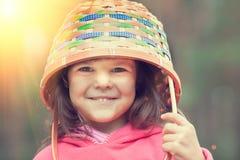Girl wearing picnic basket Royalty Free Stock Photos