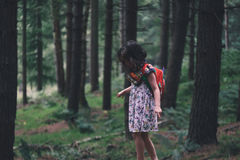 Girl Wearing Pink and Green Floral Print Dress Walking Beside Trees Stock Photo