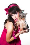 Girl wearing pink holding small dog on white Stock Photo