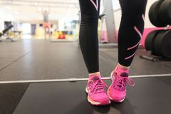 girl wearing pink running shoes on treadmill stock photos