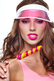 Girl wearing plastic cap holding lollipop Royalty Free Stock Photography