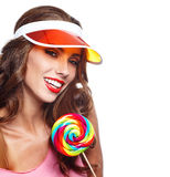Girl wearing plastic cap holding lollipop Royalty Free Stock Image