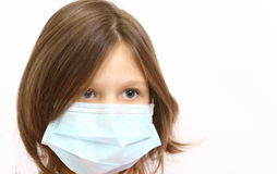 Girl wearing a protective mask. A Little girl wearing a protective mask Stock Images