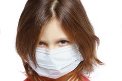 Girl wearing a protective mask Stock Images