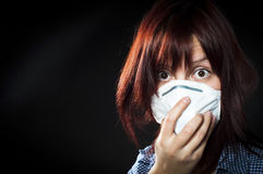 Girl wearing protective mask Stock Images