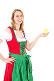 Girl wearing red dirndl and holding tiny chick in her hand Royalty Free Stock Photo