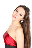 Girl Wearing Red Dress Looks At Camera Royalty Free Stock Images