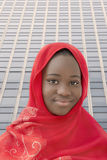 Girl wearing a red headscarf in the street, thirteen years old Royalty Free Stock Photo