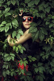 Girl wearing red sun glasses Royalty Free Stock Images
