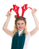 Girl wearing a reindeer headband Royalty Free Stock Photo