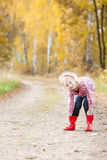 Girl wearing rubber boots Royalty Free Stock Photos