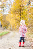 Girl wearing rubber boots Stock Images