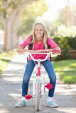 Girl Wearing Rucksack Cycling To School Royalty Free Stock Photo