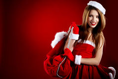 Free Girl Wearing Santa Claus Clothes Stock Photography - 22296952