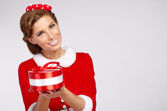 Girl wearing santa claus clothes Stock Image