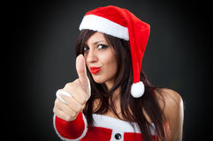Girl wearing santa claus clothes giving an ok sign Stock Images