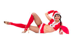 Girl wearing santa claus clothes lies Royalty Free Stock Photo