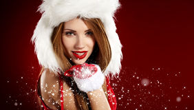 Girl wearing santa claus clothes Stock Photos