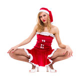Girl wearing santa claus clothes sitting Royalty Free Stock Images