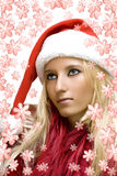 Girl wearing santa claus hat Stock Photos