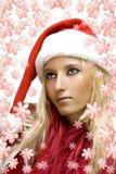 Girl wearing santa claus hat Stock Photos